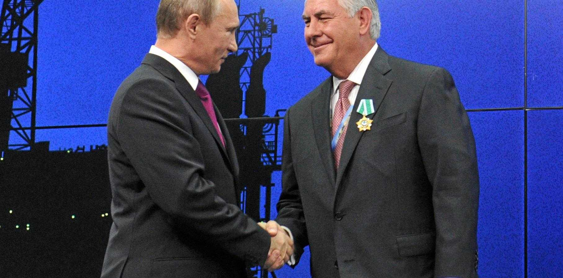In this photo taken on June 21, 2012, Russian President Vladimir Putin presents ExxonMobil CEO Rex Tillerson with a Russian medal at an award ceremony in St Petersburg
