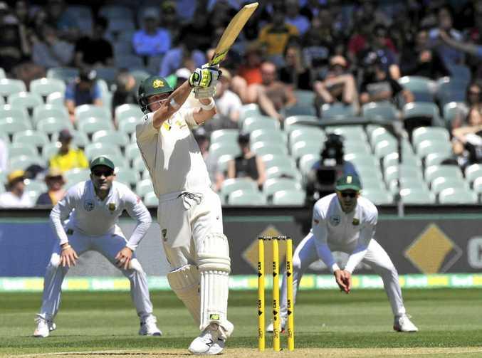 Australian batsman Steve Smith plays a shot.