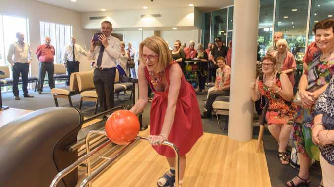 President of the Yamba Chamber of Commerce Sue Hughes lines up one of the first bowls at the new family leisure centre at the Yamba Bowling Club as member for Page Kevin Hogan watches on.