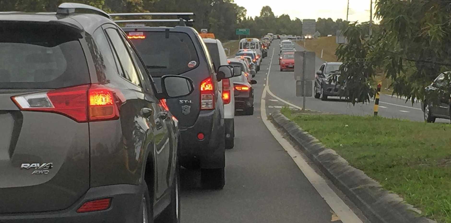 JAMMED UP: A recent Kawana Way traffic jam at about 8.30am.