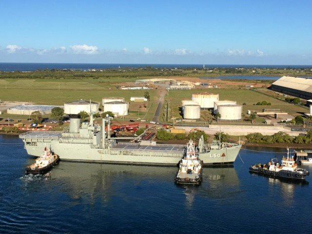 WELCOME: The ex-HMAS Tobruk entering the Port of Bundaberg.
