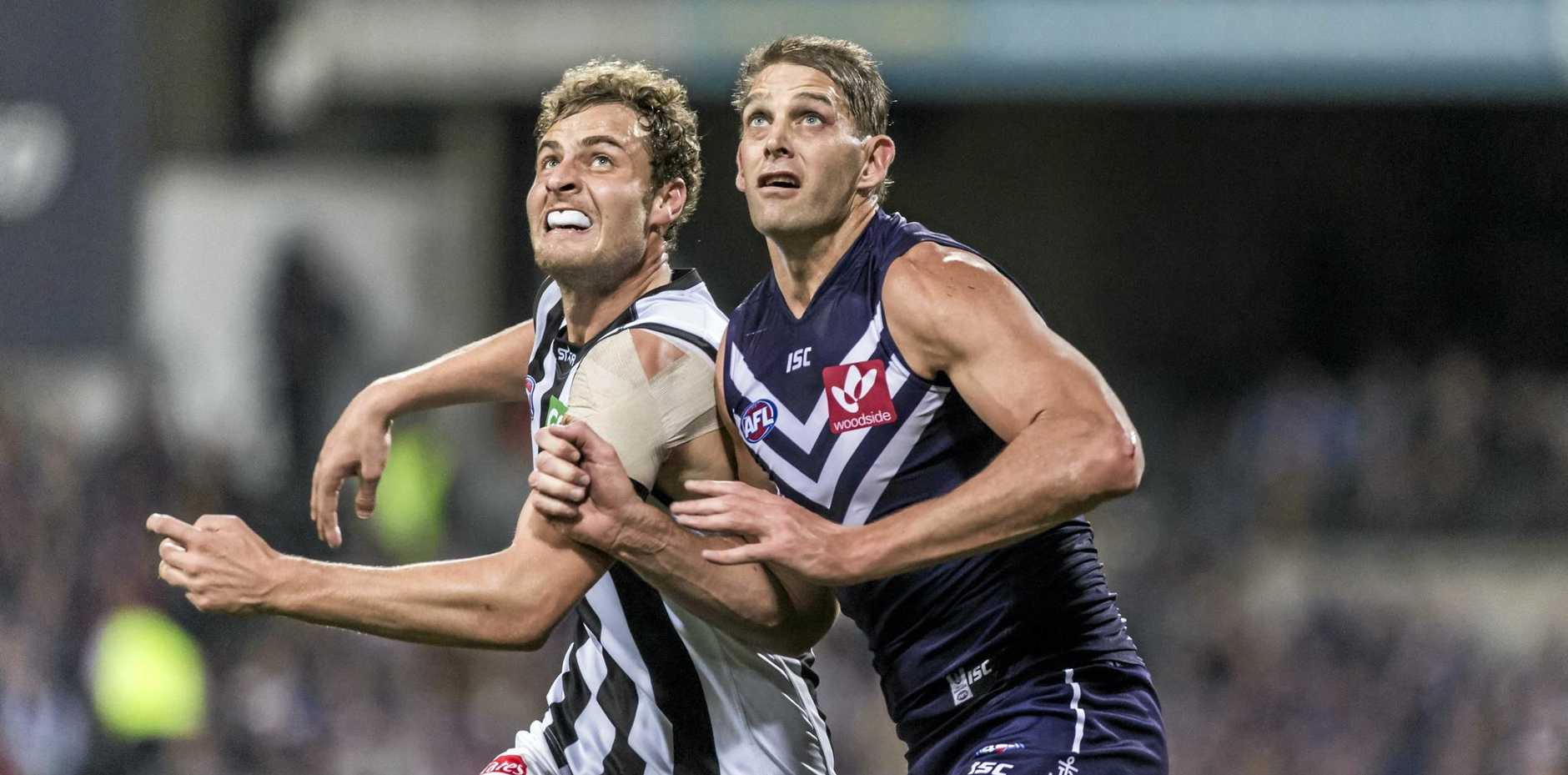 Jarrod Witts (left) takes on Fremantle big man Aaron Sandilands when still a Magpie.