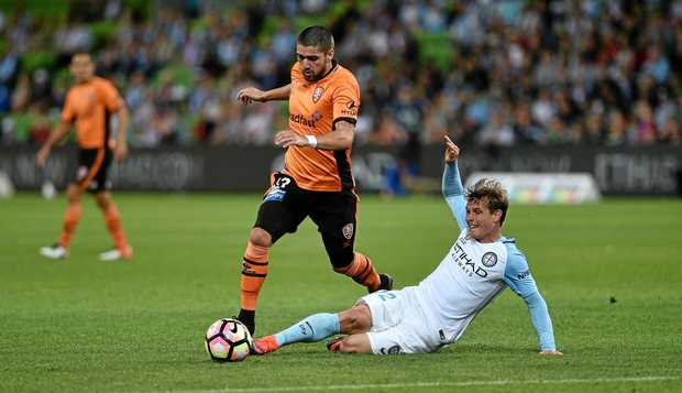 Brisbane Roar's Dimitri Petratos (left) and Melbourne City's Nick Fitzgerald in action at AAMI Park in Melbourne earlier this month.