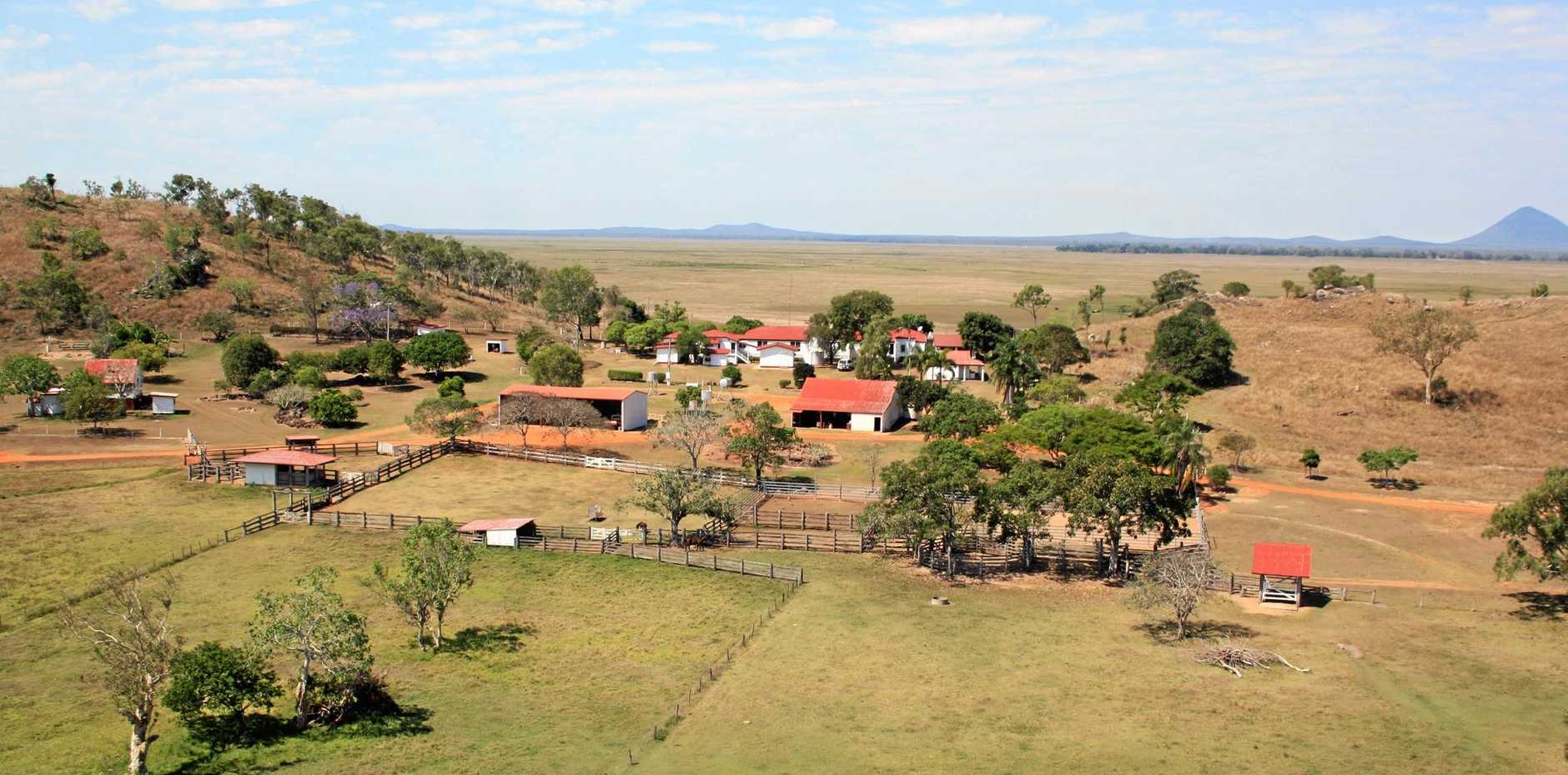 HOME SWEET HOM: An aerial view of the homestead at Toorilla Plains which runs 2,500 head of cattle. LEFT: Craig and Latisha Mace with their two children Will and Mekensi in their younger days .
