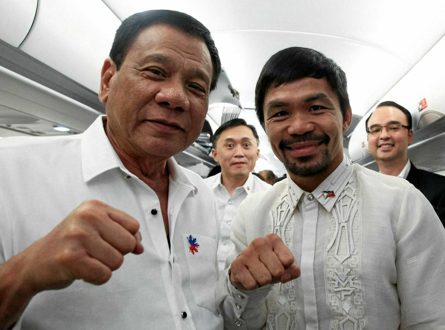 President Rodrigo Duterte rubs shoulders with senator and champion boxer Manny Pacquiao on board a Philippine Airlines plane bound for Cambodia.