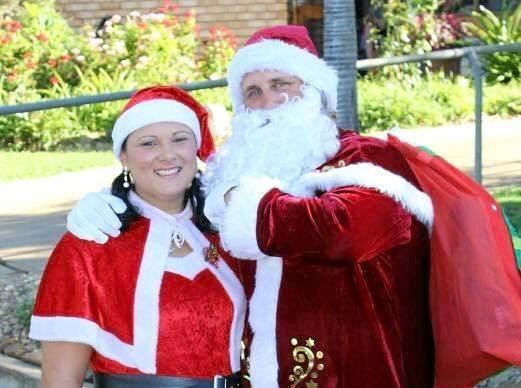 TOP TEAM: Jane Stevenson with Santa for the Clermont Santa Present Run.