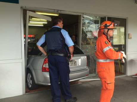 SES volunteers were called upon to cut a trapped male driver after the car drove through the entrance of Joy Noodle, South Grafton on Friday, 16th December, 2016.