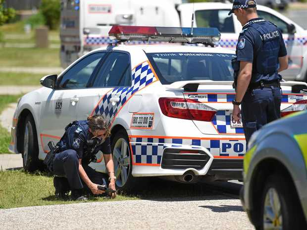 Queensland police attend a Caboolture address on February 5 last year where the infamous pursuit began.