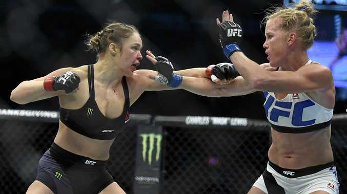 Ronda Rousey, left, and Holly Holm fight get stuck in during their UFC 193 bantamweight title bout in Melbourne in November last year.