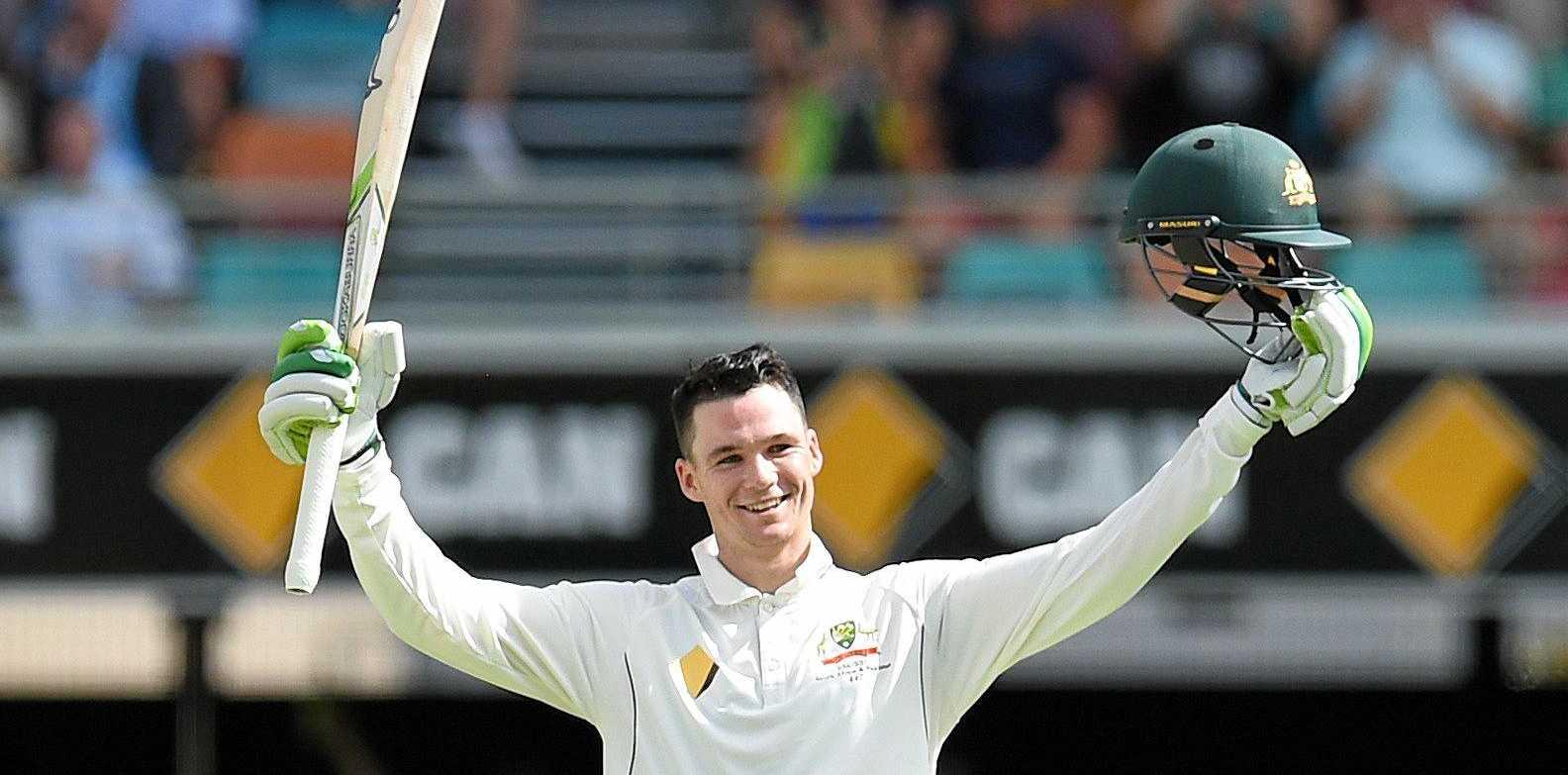 Australian batsman Peter Handscomb celebrates his maiden century.
