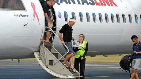 Surviviors Steve Ward and Nick Bennett disembark in Mackay after surviving an attack on the Black Cat Trail in PNG. Photo Lee Constable / Daily Mercury