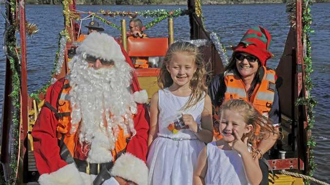 The SES Santa visits the Big River Ski Lodge. Santa with Amber and Jade Child