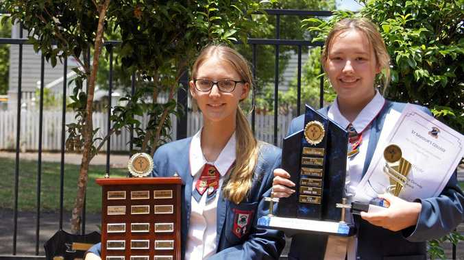 HAPPY STUDENTS: Bridget McCarron and College Captain Mia Wright celebrate with their awards after the ceremony.