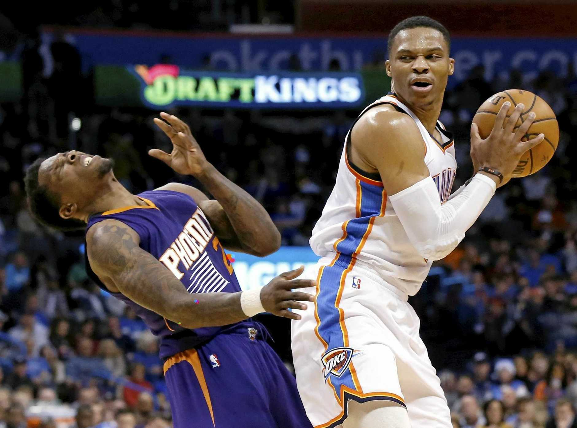 Phoenix Suns guard Eric Bledsoe (left) falls backwards following a clash with Oklahoma City Thunder guard Russell Westbrook.