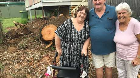 John and Judy-Ann Smith with their neighbour Marlene whose washing line was destroyed when a huge tree came crashing down in the storm.