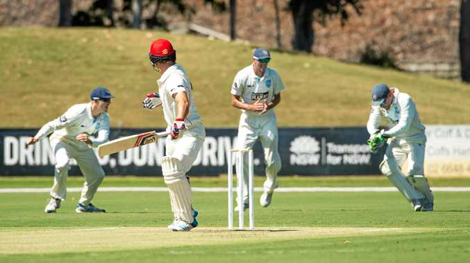 NSW wicketkeeper Ryan Carters gladly accepts a catch from South Australian batsman Sam Raphael during the Sheffield Shield match played at C.ex Coffs International Stadium.