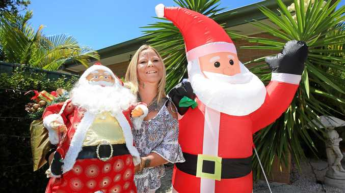 LIGHTING THE WAY: Tash Johnston from Banora Point is spreading the Christmas cheer with a garden full of decorations and lights.