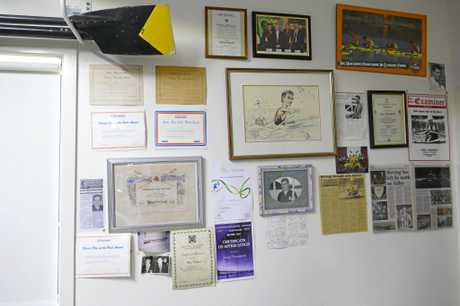 WALL OF FAME: A few reminders for Grafton Rowing Club stalwart Greg Thompson of what he achieved in a glittering career in rowing and sports administration at his home in Junction Hill.