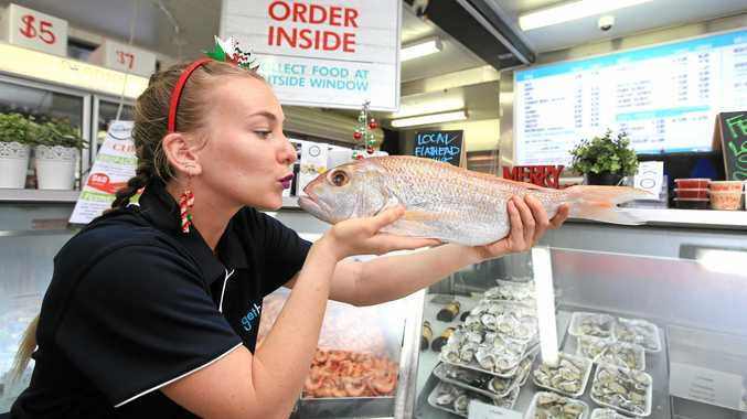 GREAT CATCH: Ruby Plomb from Get Hooked Seafood, Tweed Heads gets up close and personal with a red Snapper.