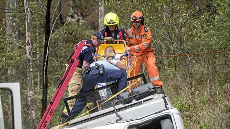 A trapped inmate is freed from a corrective services van that tipped over on the Gwydir Highway.