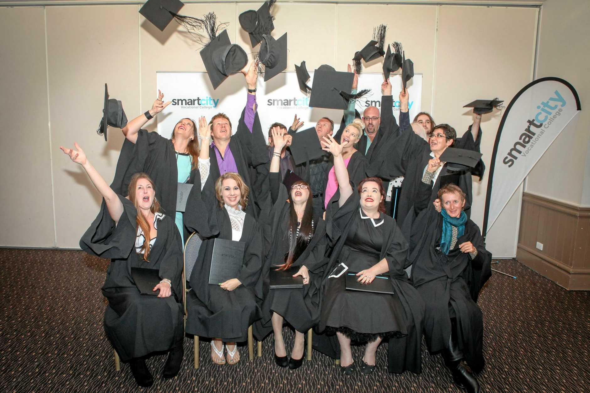 A SmartCity Graduating class celebrates in 2015.