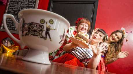 Catherine Moloney, Skye Harrison and Bhre Sonson lean into their Mad Hatter tea party themed 1st birthday celebration at the Tilted Teaspoon. Photo Adam Hourigan / The Daily Examiner