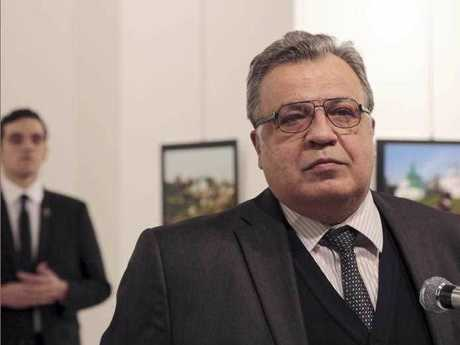 Andrei Karlov, the Russian Ambassador to Turkey, moments before a gunman opened fire on him. Karlov was rushed to a hospital after the attack and later died from his gunshot wounds. The gunman is seen at rear on the left.
