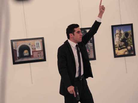 The gunman gestures after shooting the Russian Ambassador, Andrei Karlov.