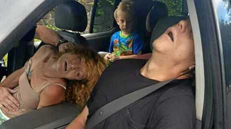The East Liverpool Police Department released this image of a young child sitting in a vehicle behind his mother and a man, both of whom are unconscious from a drug overdose.