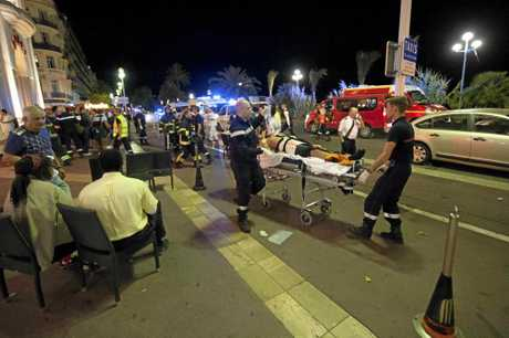 The wounded are evacuated from the scene where a truck crashed into the crowd during the Bastille Day celebrations in Nice, France on July 14.