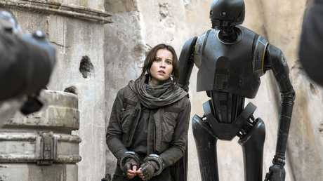 Felicity Jones and K-2SO (Alan Tudyk) in a scene from the movie Rogue One: A Star Wars Story.