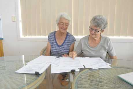 Beryl May and Judy Gibson go through their correspondence with Council over the life of the club after the locks were changed on the Minnie Water Tennis Club House.