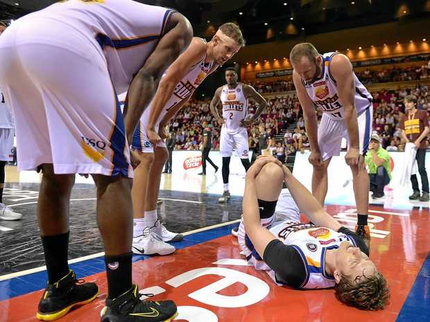Cameron Bairstow of the Bullets holds his knee during the round 11 NBL match between Brisbane and the Illawarra Hawks at the Brisbane Convention Centre.