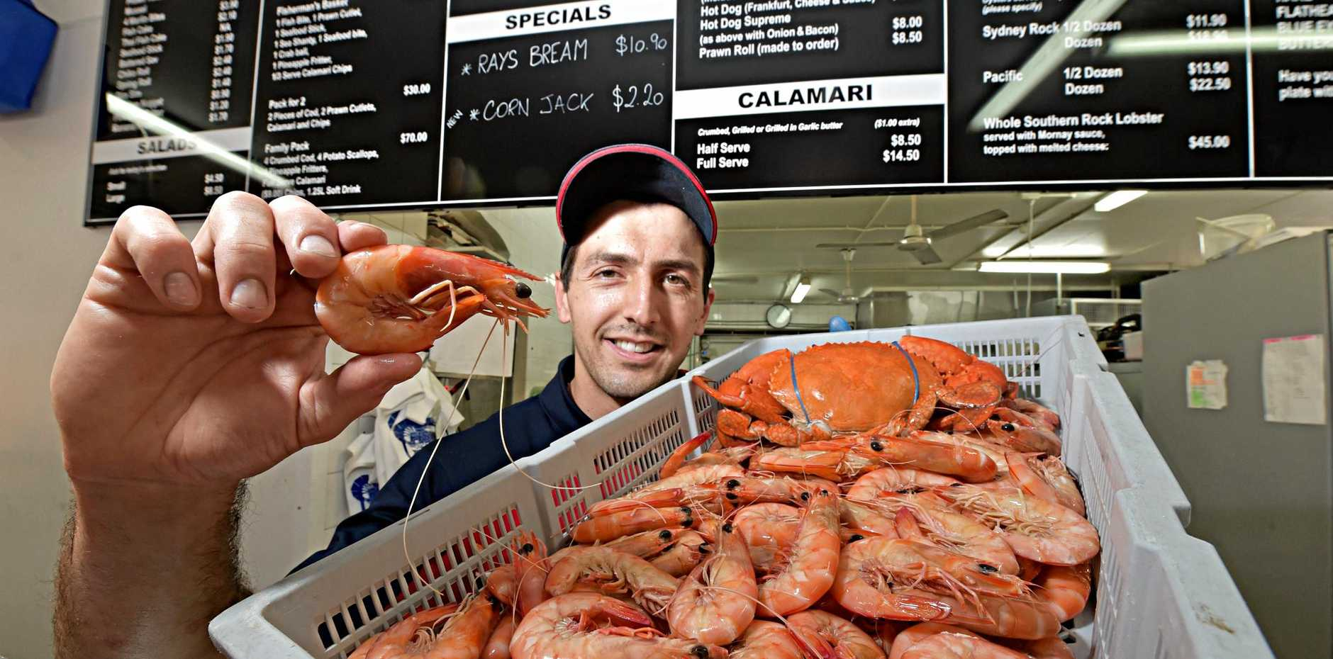 TASTY: Patrick Combettes from Fisheries on the Spit at Mooloolaba is ready for the Christmas rush with a fresh catch of prawns.