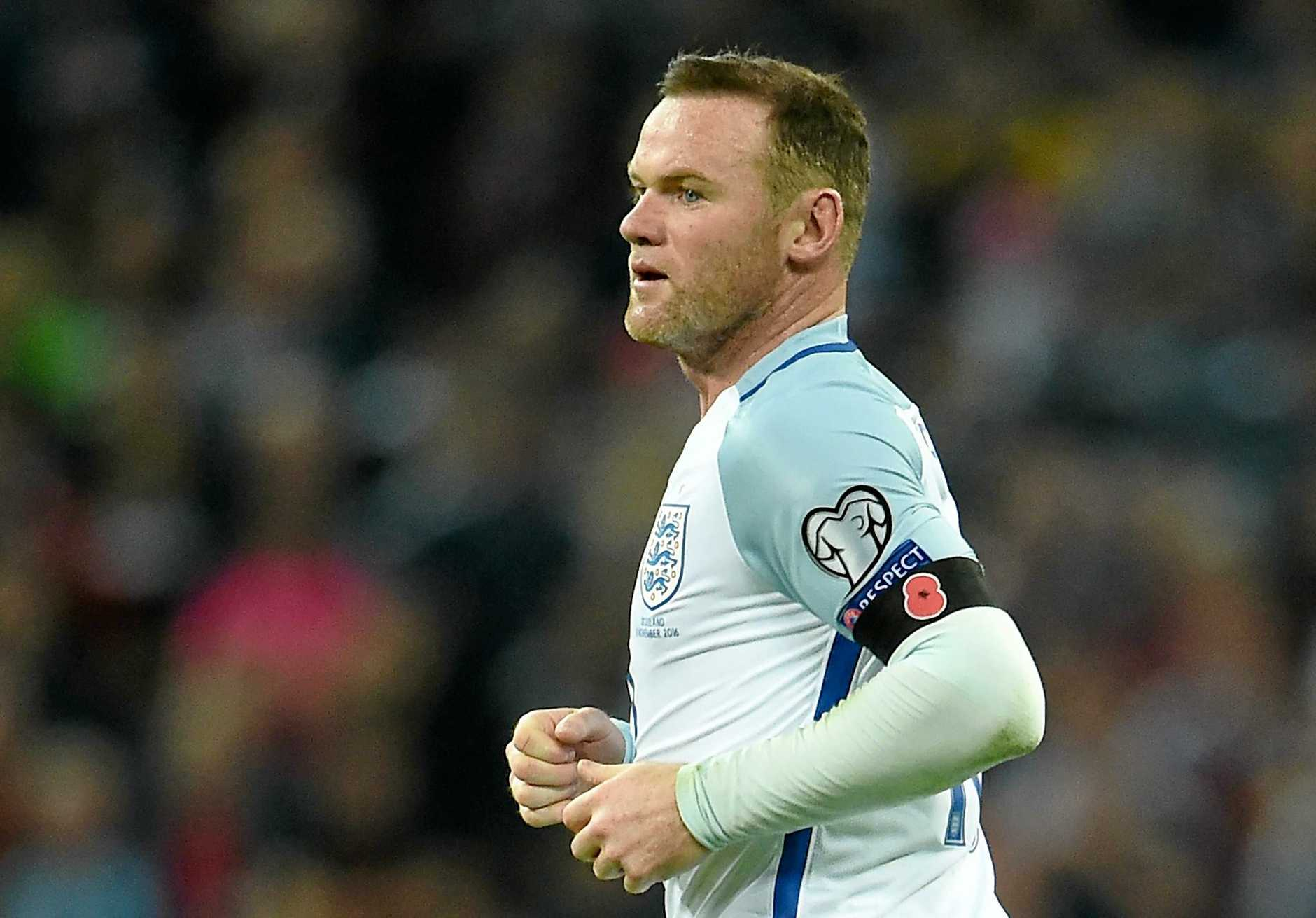 England captain Wayne Rooney with a remembrance poppy armband.