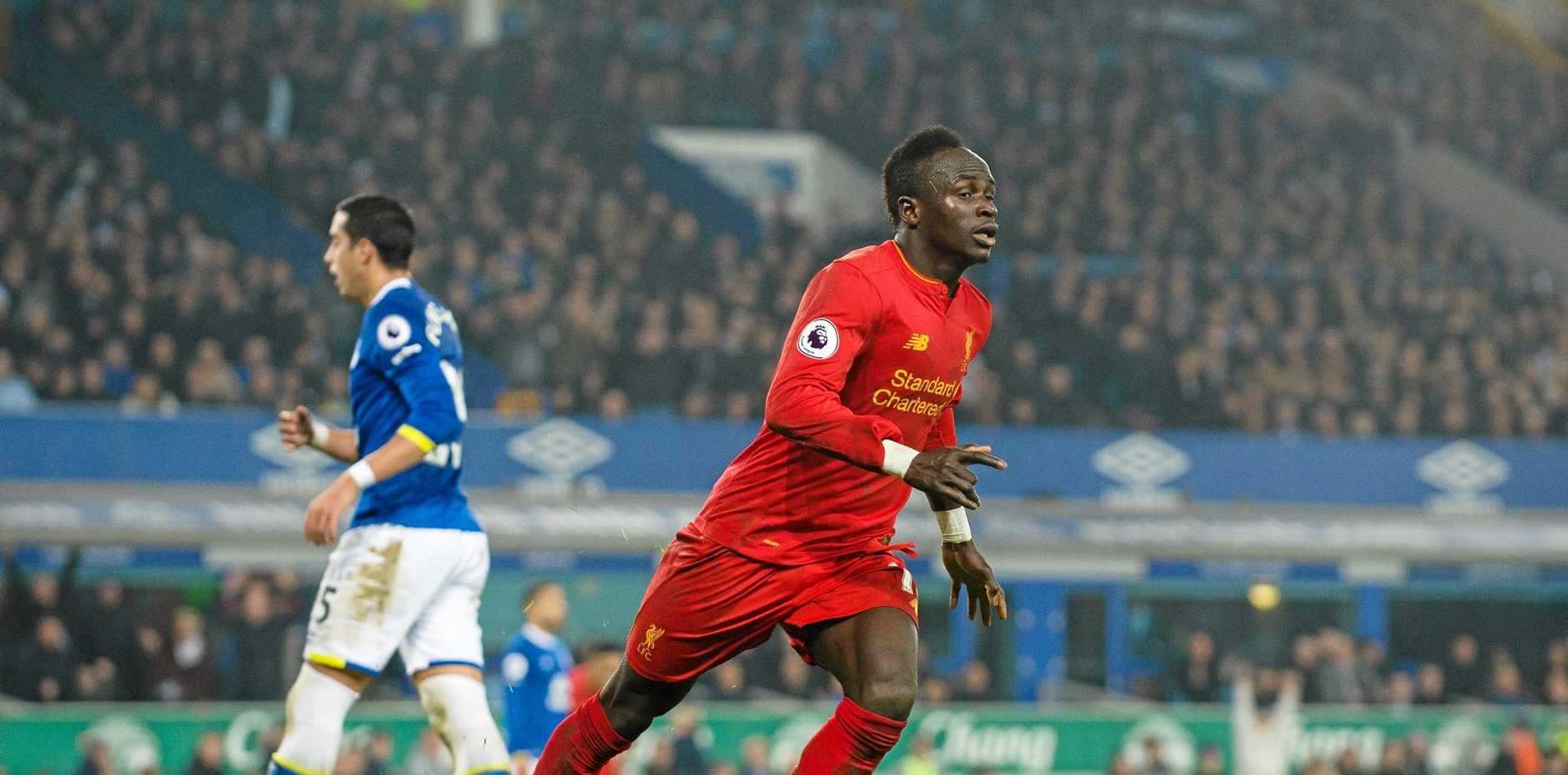 Liverpool's Sadio Mane celebrates scoring the winner against Everton at Goodison Park.