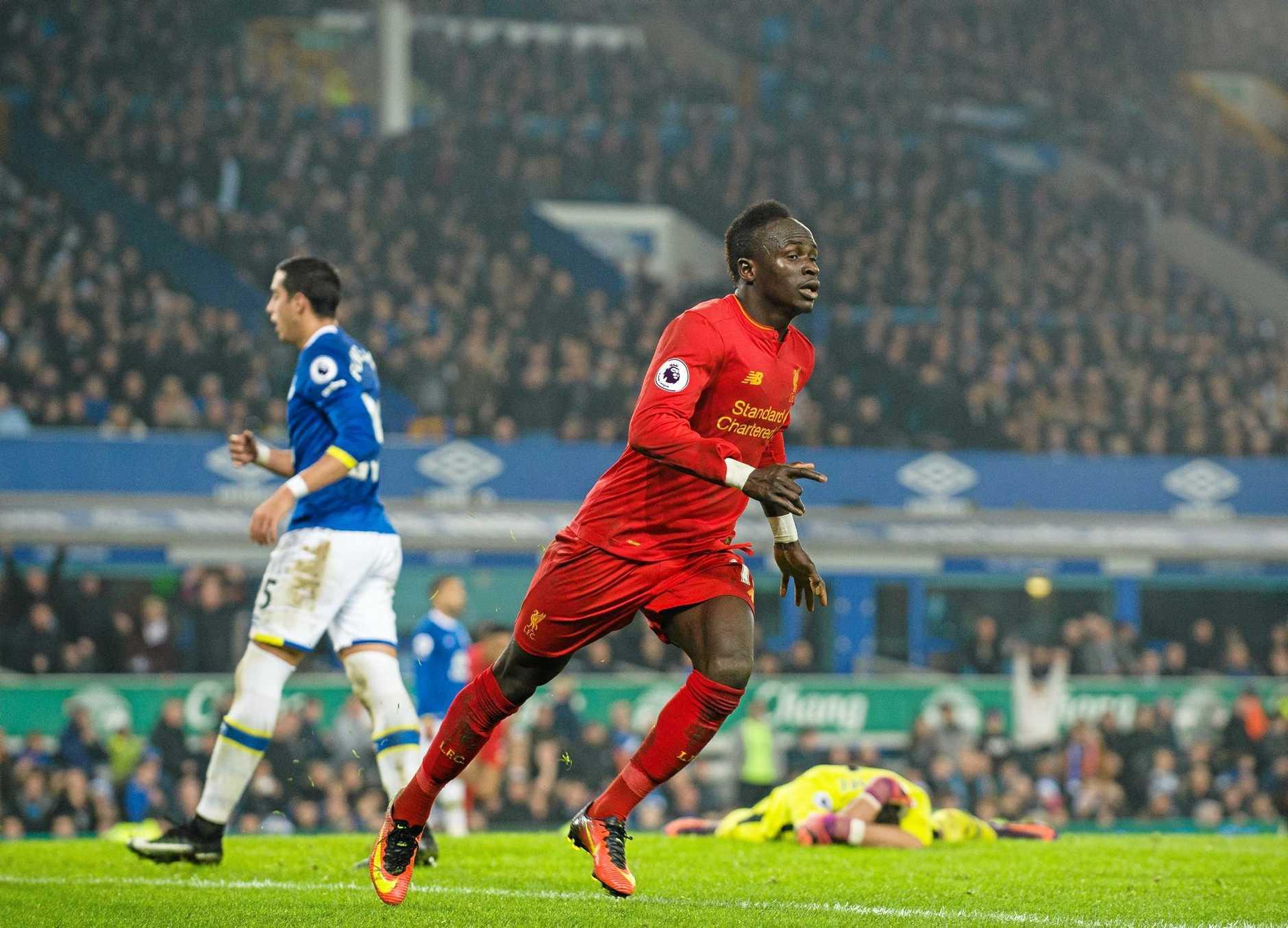Liverpool's Sadio Mane celebrates scoring the winner against Everton at Goodison Park.