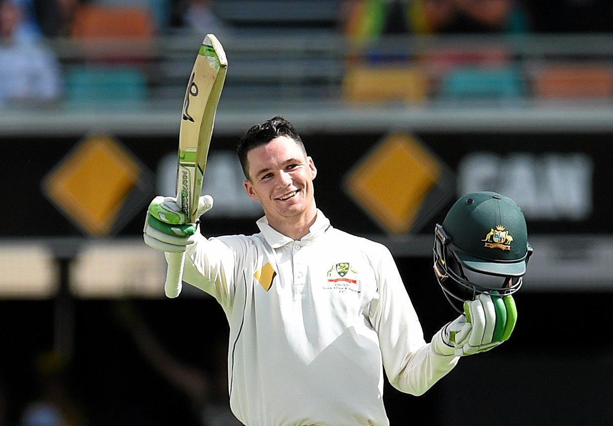 Australian batsman Peter Handscomb celebrates his maiden Test century.