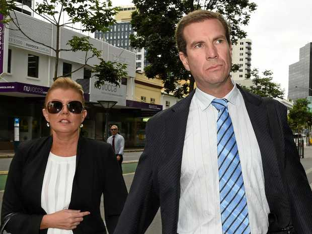 Former Billabong boss Matthew Perrin (centre) and his partner Belinda Otton (left) arrive at the district court in Brisbane, Tuesday, December 20, 2016.