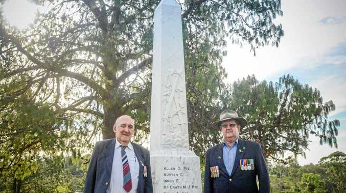 LIKE NEW: South Grafton RSL Sub Branch honorary secretary Bob Hayes and president Fred Norris with the recently refurbished Ramornie cenotaph.