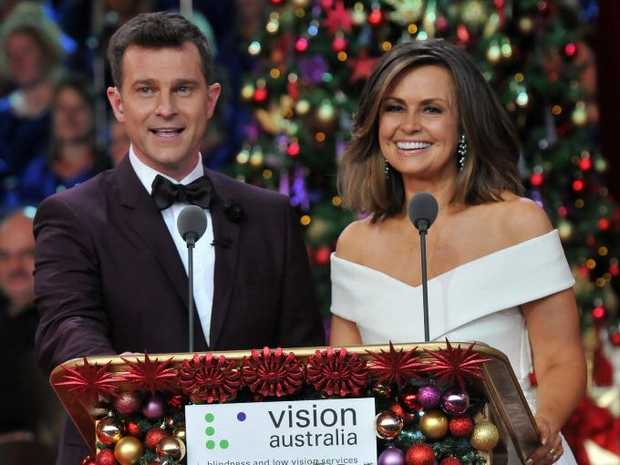 Lisa Wilkinson and David Campbell pictured hosting Carols by Candlelight in 2015.