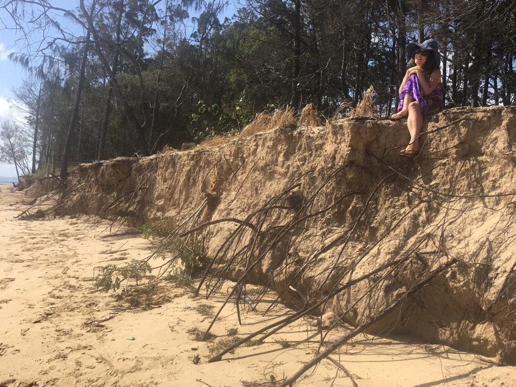 Aliza Francis at the site of the erosion at Urangan.