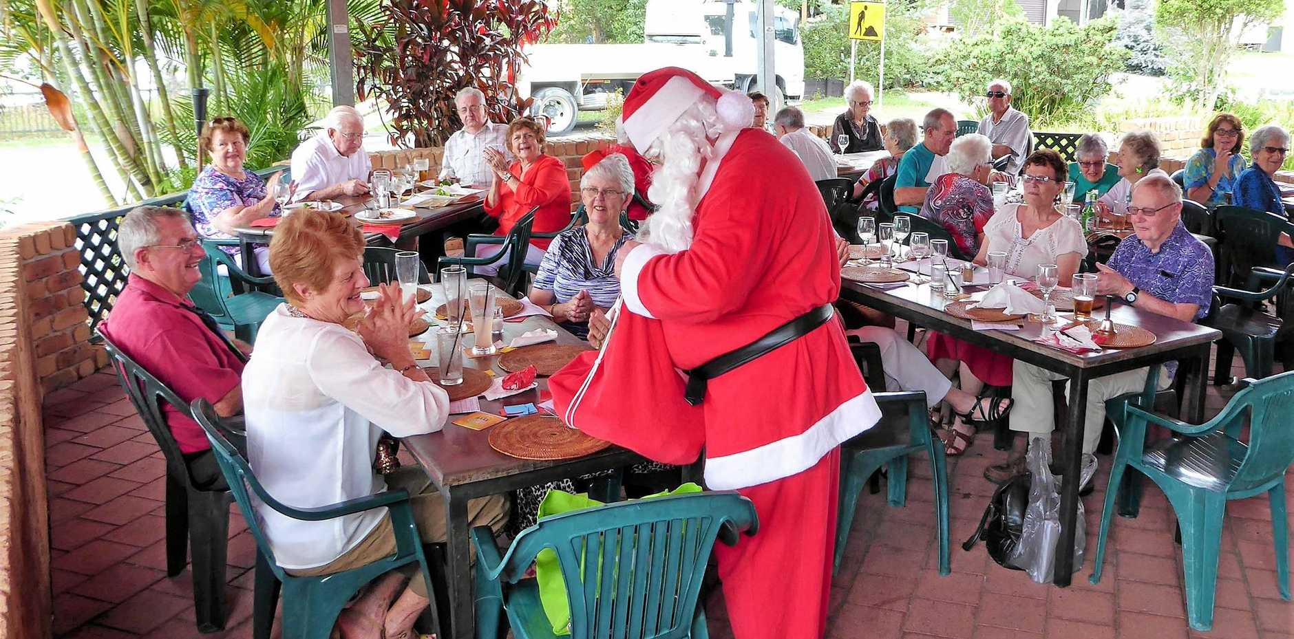 SPIRIT OF GIVING: Probus Club of Grafton Inc members celebrating a Merry Christmas with Santa.