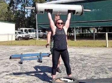 POWER PACKED: Strongwoman competitor Ainslee Gordon, of Maleny, demonstrates a log lift.
