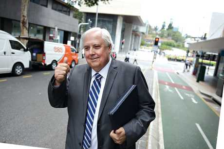 Former federal MP Clive Palmer gives the thumbs up as he leaves Brisbane Supreme Court.