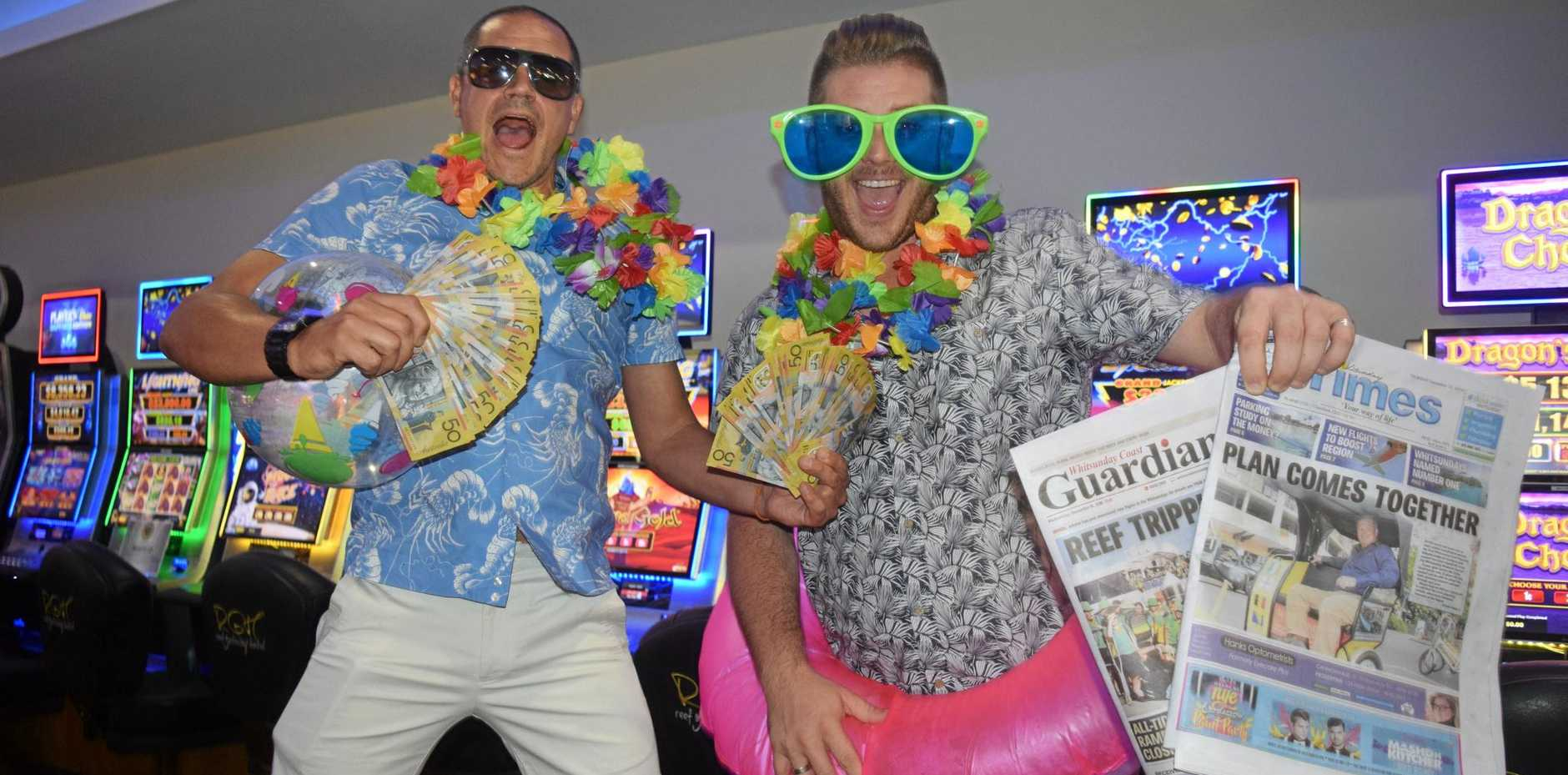 CASH CRUISIN': Reef Gateway marketing manager Mark Wilkins and Whitsunday Times and Whitsunday Coast Guardian general manager Steven Jacklin in their cash or cruise competition.