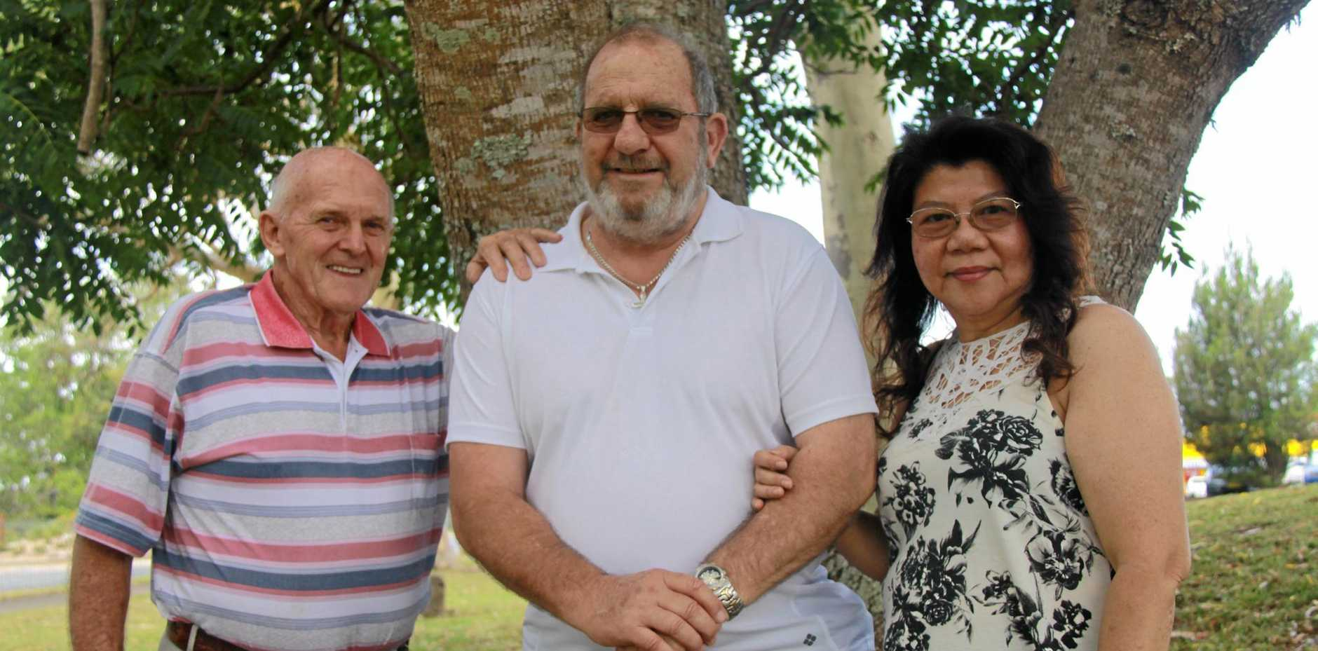 FRIENDS FOR LIFE: David Francis (white shirt) can't thank his new mate Douglas Marks and sweetheart Zemy Rochester enough for saving his life earlier this month when they combined efforts to get him to hospital.