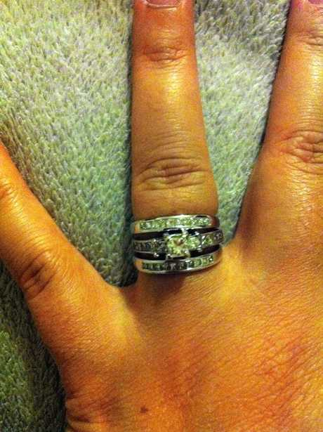 MISSING: White gold wedding band, engagement ring and eternity ring with channel set princess cut (square) diamonds.