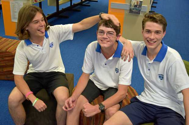 WINNING WORDS: Mitchell Pitman (centre) won the ABC Heywire story competition. Pictured here with friends James Scarborough, 17, and Jesse Hughes, 17, at the Casino High School library.