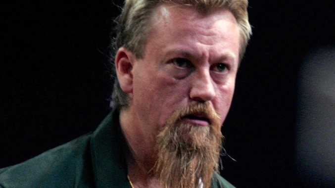 Australian darts player Simon Whitlock.
